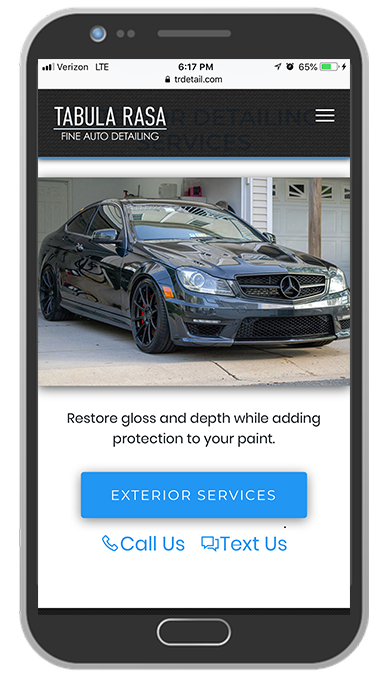 Iphone with NKYDetailing.com Pulled up in the web browser - responsive mobile friendly website